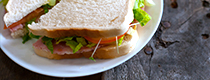 freshly made sandwich on white bread with salad