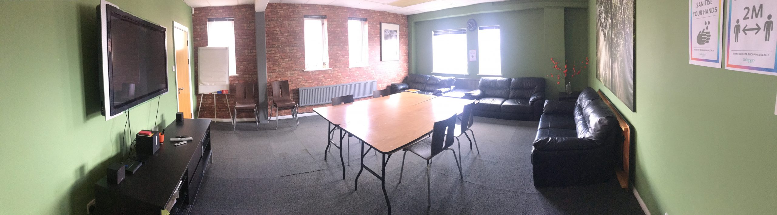 panoramic view of training room with central table and chairs