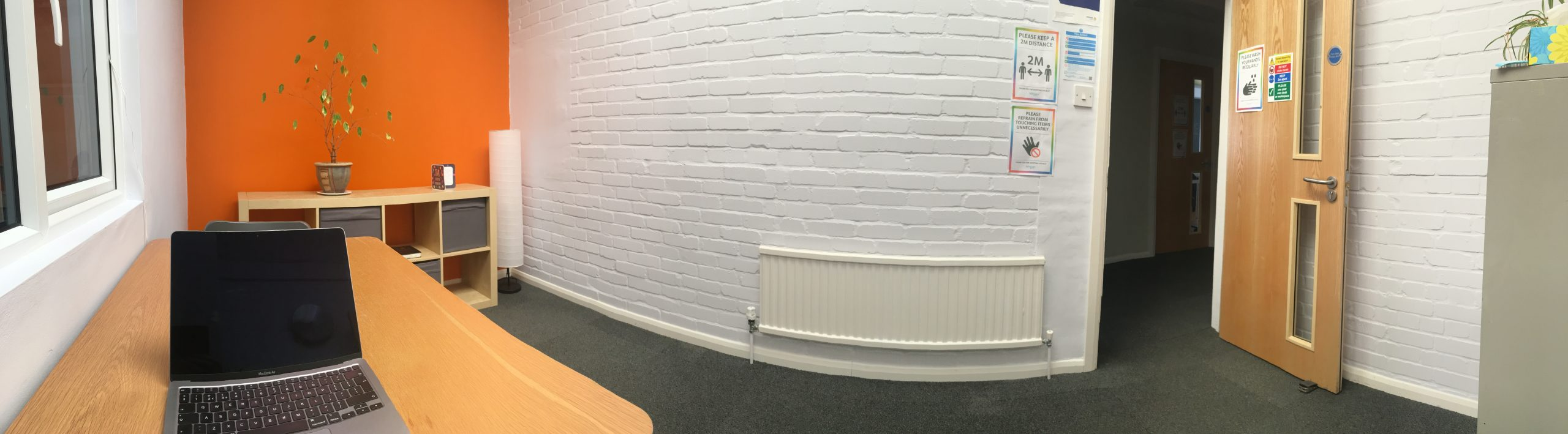 panoramic view of small meeting room with one desk